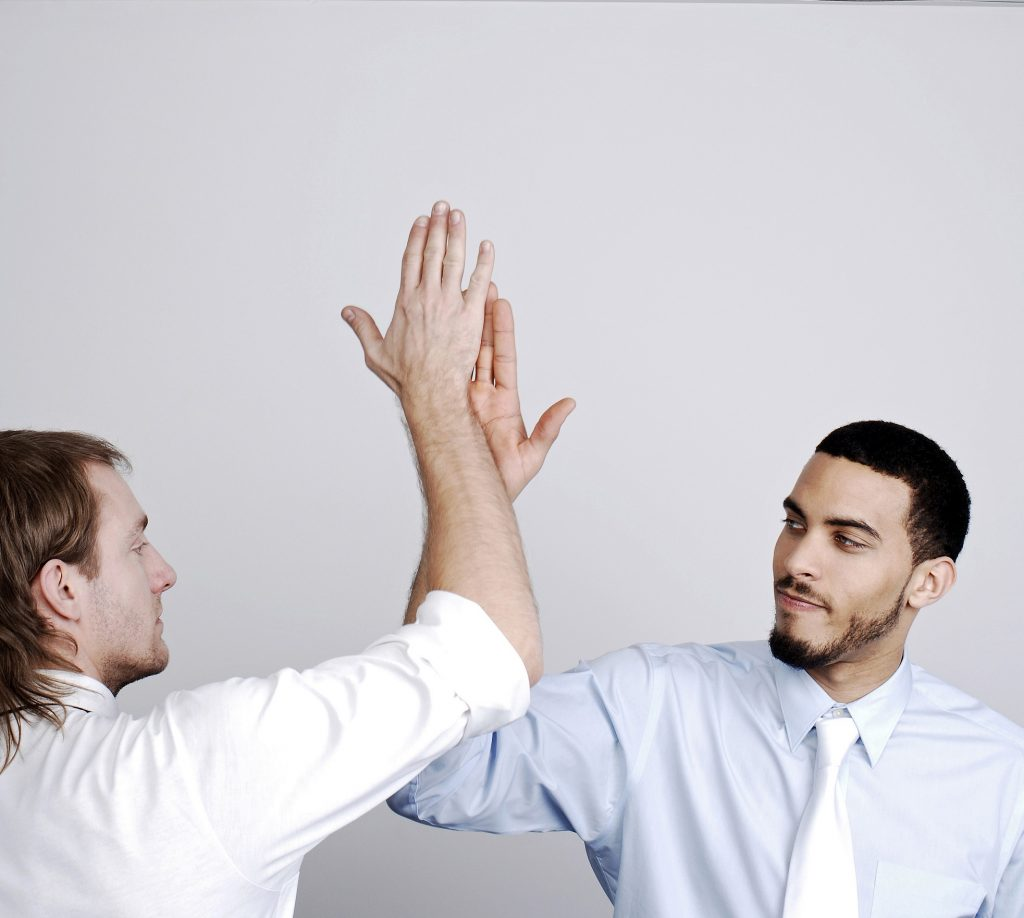 two guys high five