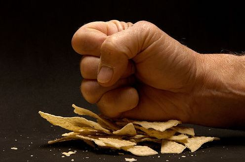 Fist crushing chips demanding better